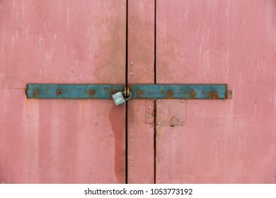steel door closed to padlock