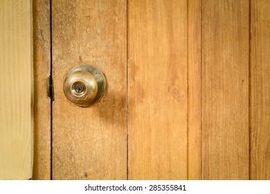 steel door knob on the wooden door