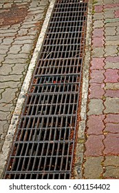 Steel drain cover on pathway