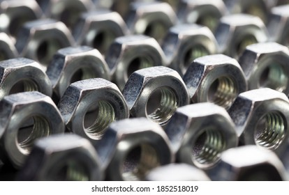steel fasteners bolt nuts made of high-quality alloy steel and other elements for secure fastening of elements, nuts are used for fixing various elements, close-up nut - Shutterstock ID 1852518019