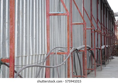 Steel fence around the construction area. Metal sheet fence