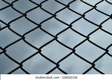 Steel Fence on Cloudy Background