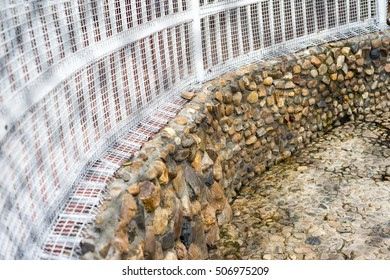Steel fence on a stone wall for caged animals