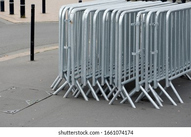 Steel fencing to ensure the safety of people during events, rallies and strikes. Background, texture.