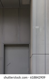 Steel fire escape door and perforated metal cladding, steel door, fire exit, minimal signage