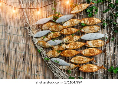 Steel fishes pattern is become rusty. It caught in nets to decorated on wood wall and lighting,The abundance of the sea or place to sell fish or fish market.