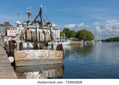 Steel fishing ship in Harbor Honfleur with bright sun, France