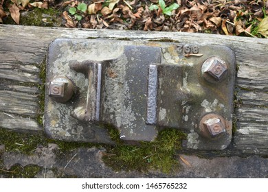 steel fitting on a wooden rail in autumn