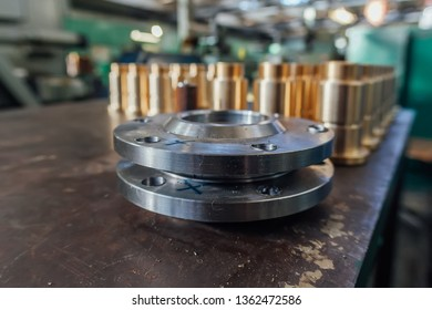 Steel flanges for industrial plumbing, selective focus