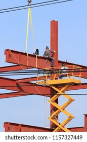 Steel frame structure and working man under construction
