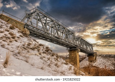 Steel girder railway bridge crossing main west coast line next to Grand Union Canal, London, England, UK