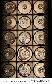 Steel grating door with circles glass