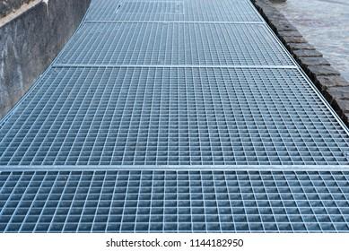 steel grilles on walkway