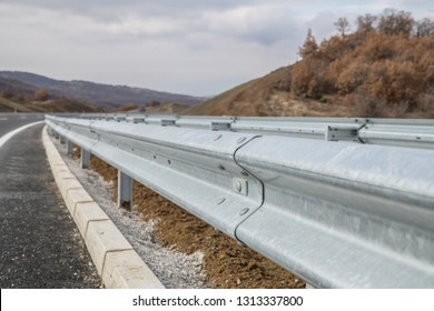 Steel guard rail barrier on the motorway without reflective sign