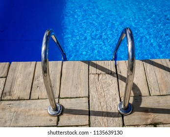 Steel handle bars of the swimming pool