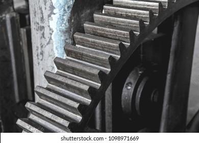 Steel huge gear. Flywheel from an old machine in a factory.Steel huge gear. Flywheel from an old machine in a factory.