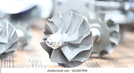 Steel impeller for Turbo charger  , component parts for diesel engine ; made from steel casting  loss wax and machining process.industrial background
