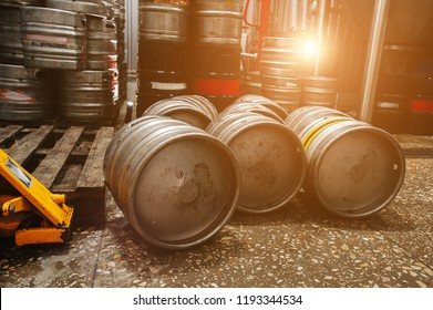 Steel industrial stack of beer kegs against. Modern brewery and equipment machinery tools for alcohol production.