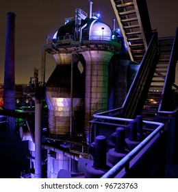 steel industry blast furnace factory or plant abandoned old vintage and historical industrial architecture at night with colored lights Landschaftspark Duisburg, Germany