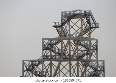 A steel and iron old structure in Kachch India in evening. backdrop is of clear sky. multi story iron and steel building, steel stairs, iron stairs,