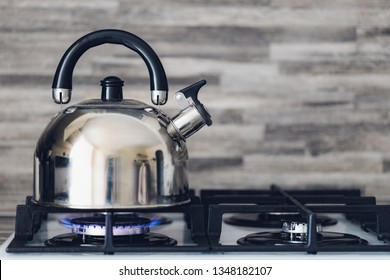 steel kettle on a gas stove, home cooking, boil water