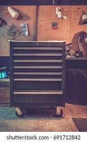 Steel locker in custom garage, vintage background with copy space