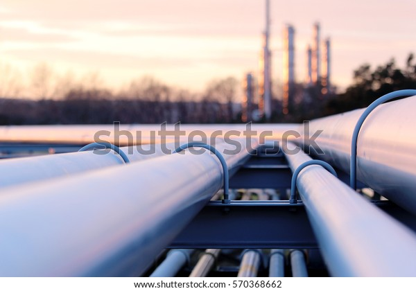 steel long pipes in crude oil factory during sunset