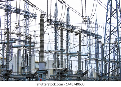 Steel masts of high voltage power lines at the plant. Electrical substation, power converter, high voltage electric power substation