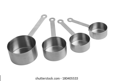 Steel measuring cups on white background