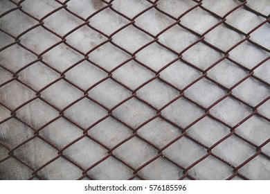 Steel mesh fence are rust on the wall