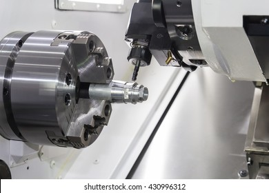 Steel metal cutting machine process by CNC lathe in workshop