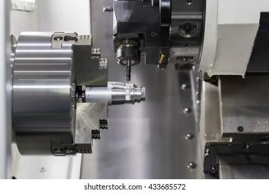 Steel metal cutting machine process by CNC lathe in workshop
