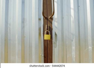 steel metal gray gate locked with padlock