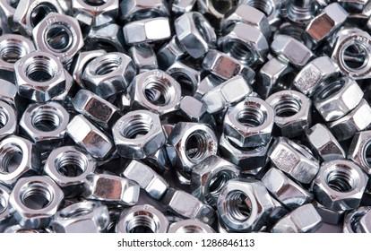 Steel nuts for screws
