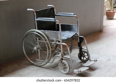 steel old wheelchair and blue Cusion