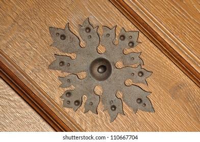 Steel ornament on wooden door