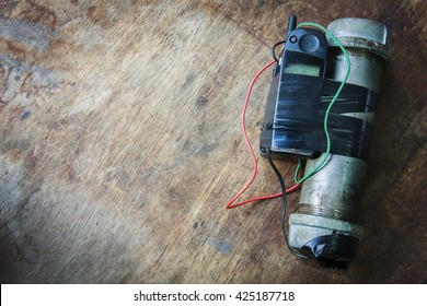 Steel pipe explosive (IED) is ignited by cell phone.For texture and background.
