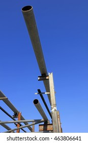 Steel pipe support under blue sky