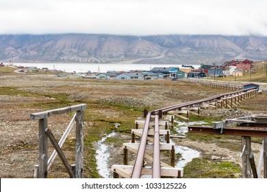 Steel pipeline leading to the village of Longyearbyen, Svalbard, Norway.