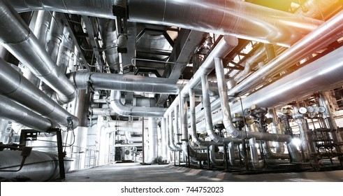 Steel pipelines and valves in blue tones