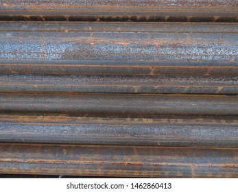 Steel pipes of different sizes, storage of steel pipes. The pipes are rusty and stale