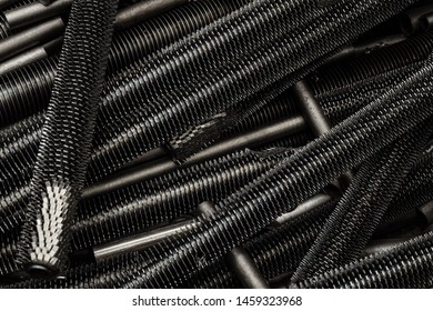 Steel pipes with spiral fins. Details of industrial convector radiators close-up.