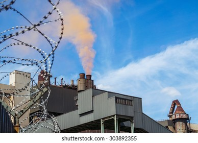 Steel plant with barbwire fence