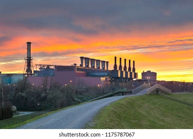 A steel plant with stunning evening sky looking like it is on fire.