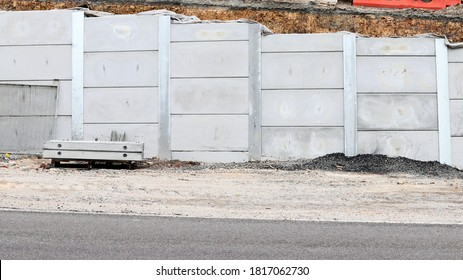 Steel post and concrete insert retaining wall