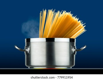 steel pot with spaghetti cooking on induction plate