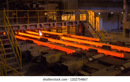 Steel production, metal construction plant. Metal rolling process. Hot red steel.