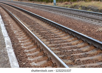 Steel rails on concrete sleepers covered with gravel, double track railway