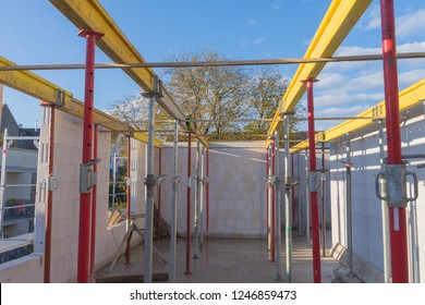 Steel raw posts and wooden beams for prefabricated concrete parts of the storey ceiling