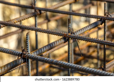 steel rebar for reinforcement concrete at construction site with house under construction background,Industrial background.Rusty rebar for concrete pouring.